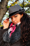 Girl with Hat. Young brunette girl with jacket scarf and hat Royalty Free Stock Photos