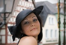 The girl in a hat Stock Images