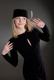 The girl in a hat. The blonde in a black dress and a hat Royalty Free Stock Images