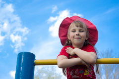 Girl in the hat. Five-year-girl in the hat in the sky royalty free stock photo