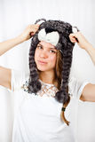 Girl with hat. A beautiful young woman in bear cap Stock Photos