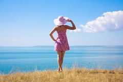 Girl in the hat. The girl in the hat by the sea Royalty Free Stock Image