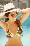 Girl with hat adn sunglasses in swimming pool. Girl having fun in swimming pool stock photos