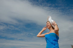 The girl in the hat against the blue sky. Stock Images