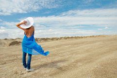 The girl in the hat against the blue sky. Stock Image