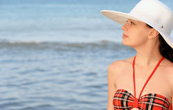 The girl in a hat against the sea Royalty Free Stock Photo