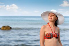 The girl in a hat against the sea Royalty Free Stock Photography