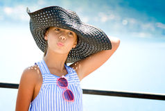 Girl in hat against sea Royalty Free Stock Image