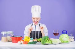 Girl in hat and apron. Cooking healthy food. Fresh vegetables ingredients for cooking meal. Lets start cooking. Woman. Chef cooking healthy food. Gourmet main royalty free stock photo