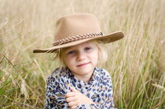 Girl with hat in autumn meadow Royalty Free Stock Image