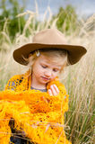 Girl with hat in autumn meadow Stock Images