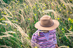Girl with hat in autumn meadow Stock Image