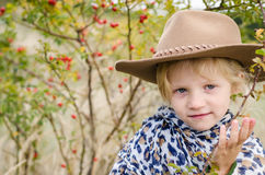 Girl with hat in autumn season Stock Photos