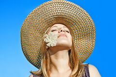 Girl in hat on a background of blue sky. Girl in a hat on a background of blue sky Stock Photo