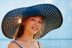 Girl in a hat on a background of ocean Royalty Free Stock Photography