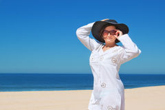 Girl in the hat on the beach. Stock Image