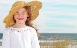 Girl in Hat on Beach Stock Images