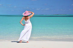 Girl in the hat on the beach Stock Photos