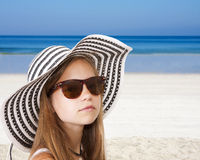 Girl with hat on the beach Stock Image