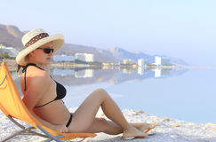 Girl in a hat on the beach relaxing Stock Photos
