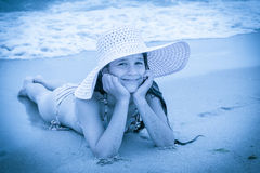 Girl in hat on the beach Royalty Free Stock Images