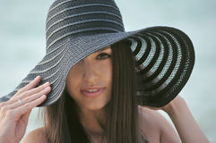 Girl in the hat. Beautiful girl in black hat on sea Royalty Free Stock Photography
