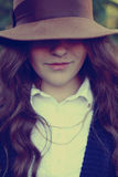 Girl in the hat. Beautiful girl in brown hat Stock Photography