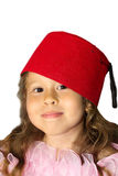 Girl with hat. Beautiful little girl with long hair and with red hat Andalusian style stock image