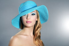 Girl in hat with beautiful make-up Stock Image