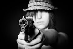 Girl in hat with a big pistol Royalty Free Stock Photography