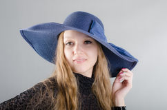 Girl in a hat and a black dress. Beautiful young girl in a hat and a black dress Stock Photography