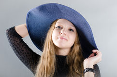 Girl in a hat and a black dress Royalty Free Stock Photo
