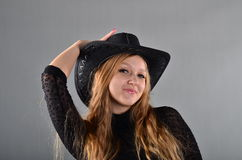 Girl in a hat and a black dress. Beautiful young girl in a hat and a black dress Royalty Free Stock Photos