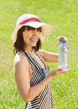 Girl in hat with bottle of water Royalty Free Stock Photo