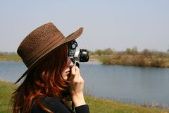 The girl in the hat with the camera Stock Images