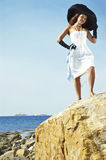 Girl in a hat on a coast of the sea Royalty Free Stock Photos