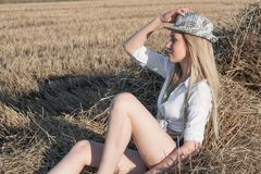 Girl in a hat in the countryside stock photo