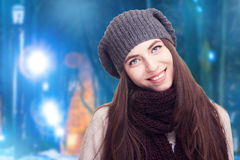 Girl with hat in cozy clothes on winter background Royalty Free Stock Image