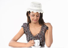 Girl with hat and cup of coffee Stock Photos
