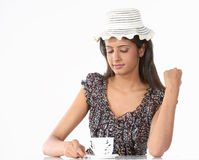 Girl with hat and cup of coffee Stock Photography