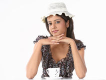 Girl with hat and cup of coffee Royalty Free Stock Image