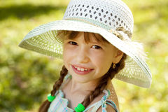 Girl in the hat and dress Stock Photography