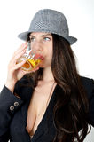 Girl with hat and drink Royalty Free Stock Photography