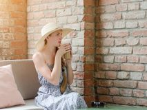 Girl in a hat drinks latte in a street cafe. Travel and Leisure Stock Photography