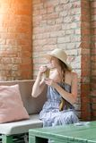 Girl in a hat drinks latte in a street cafe. Travel and Leisure Stock Photos