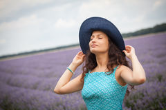 Girl with hat, enjoying the lavender field Stock Images
