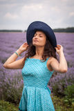 Girl with hat, enjoying the lavender field Stock Photography