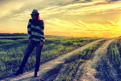 Girl in hat fashion field sunset Stock Images