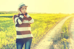 Girl in hat fashion field sunset Stock Photo