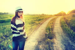 Girl in hat fashion field sunset Royalty Free Stock Images